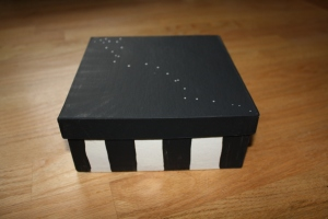 The painted box. I did circus stripes on the bottom and a black top with the star pattern found on pages throughout the book.