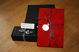 Here's the gift with the addition of 8 truffles in dark and white chocolate. I didn't have time to order chocolate mice like in the book, but I figured gourmet truffles were good enough on short notice! The candy store didn't have a black box so I had to make one out of black card stock - that was fun to learn how to do. That's tied with silver ribbon, and has a little message attached.