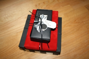 So here's the gift, all wrapped up in black ribbon. It's got the color scheme, it's got the pocket watches - I was SO EXCITED to give this to him.